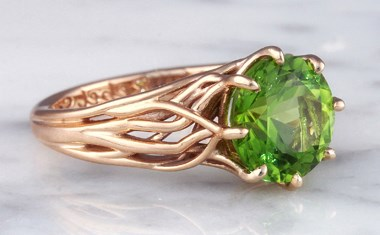 tree of life engagement ring in rose gold with peridot