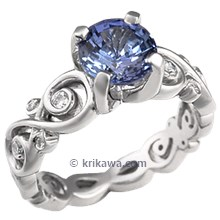 Contemporary Infinity Engagement Ring with Blue Sapphire