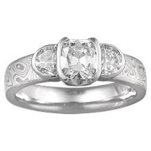 Cushion Cut Diamond in Three Stone Engagement Ring with White Mokume - top view