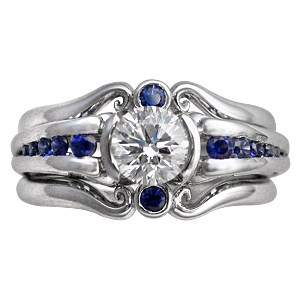 Carved Curls Engagement Ring with Tapering Blue Sapphires and Enhancer