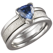 Modern Scaffolding Engagement Ring with Blue Sapphire