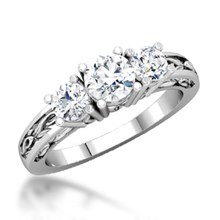 Three Stone Engagement Ring With Carved Band