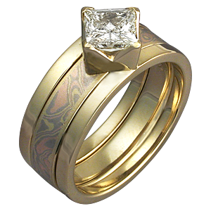 yellow gold modern scaffolding engagement ring and trigold