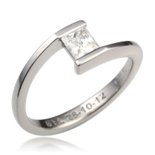 Sleek Solitaire Crossover Engagement Ring