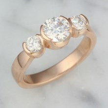 Modern Rounds Three Stone Engagement Ring