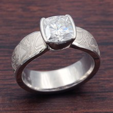 Mokume Solitaire Tapered Engagement Ring With Cushion Cut Moissanite