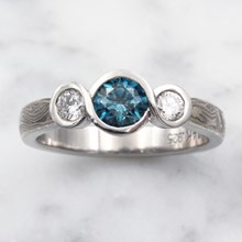 Mokume Infinity Engagement Ring With Blue Diamond - top view