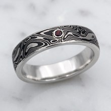 Black And White Mokume Wedding Band With Garnet Accent