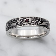 Black And White Mokume Wedding Band With Garnet Accent - top view