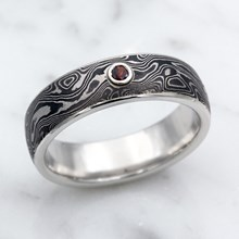 Platinum and Mokume Wedding Band With A Garnet Accent