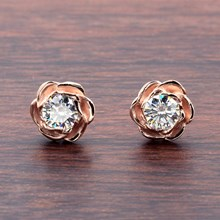 Large Rose Gold Rose Stud Earrings With Moissanites - top view