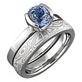 Modern Solitaire Engagement Ring with Blue Sapphire and Mokume Wedding Band
