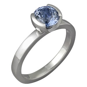 Modern Solitaire Engagement Ring with Blue Sapphire