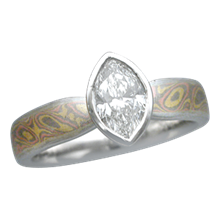 Mokume Solitaire Tapered Engagement Ring with a Marquise Diamond