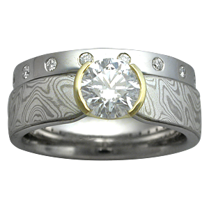 Mokume Solitaire Tapered Engagement Ring with a Straight Diamond Band