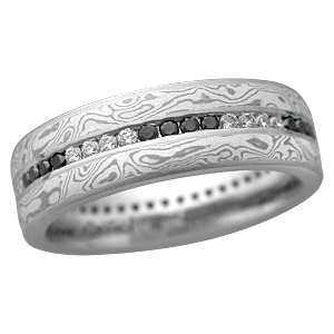 mokume wedding band with black and white diamond accents