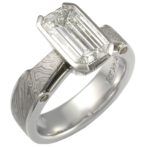 Emerald Cut Diamond in Mokume Bridge Engagement Ring