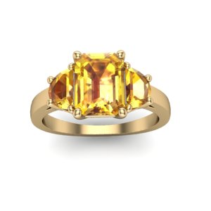 yellow sapphire and yellow gold three stone engagement ring