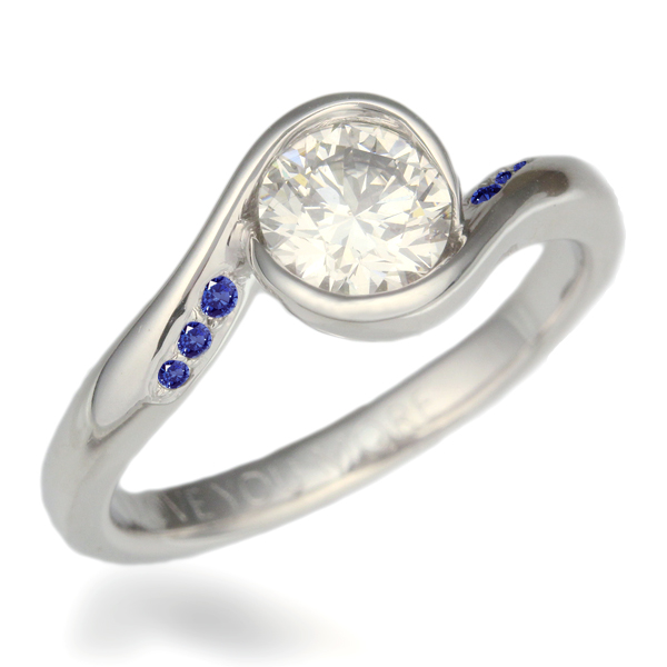Carved Wave Light Engagement Ring with Round White Diamond and Medium Blue Sapphire Accents