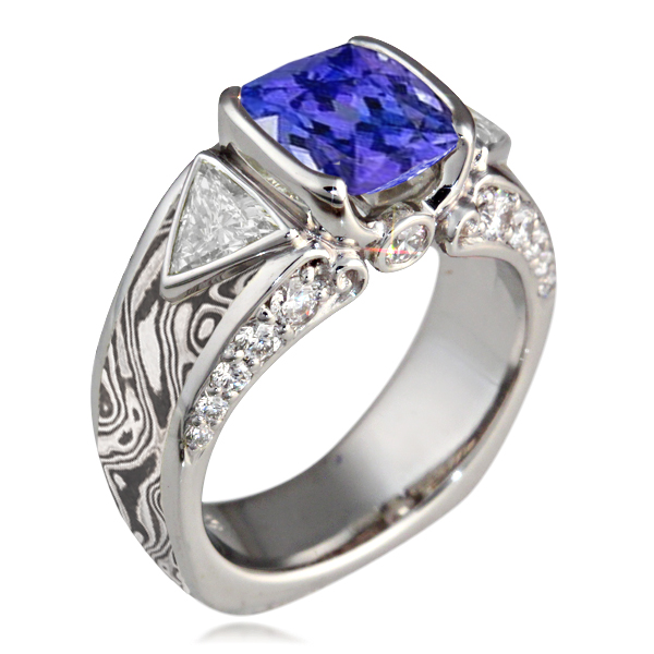 Elegant Mokume Carved Curls Engagement Ring with Tanzanite Center Stone