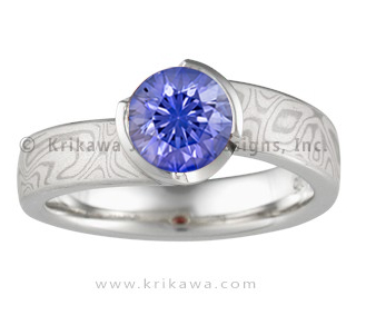 unique engagement ring with round blue sapphire