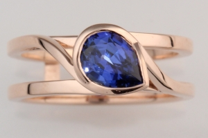 swirl pear shaped  blue sapphire engagement ring