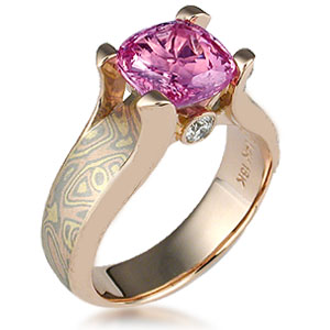 Pink sapphire and rose gold engagement ring