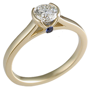 Modern Engagement Ring in Yellow Gold with Blue Sapphire Surprise Stone