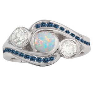 Three Stone Channel Engagement Ring with Center Opal and Sapphire Accents
