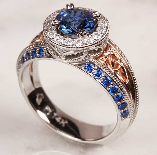 Gorgeous platinum and rose gold engagement ring with blue sapphries