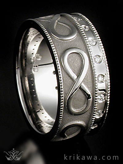 Beautiful wedding band with infinity symbol, millegraining and diamonds