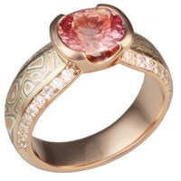 oval salmon spinel engagement ring