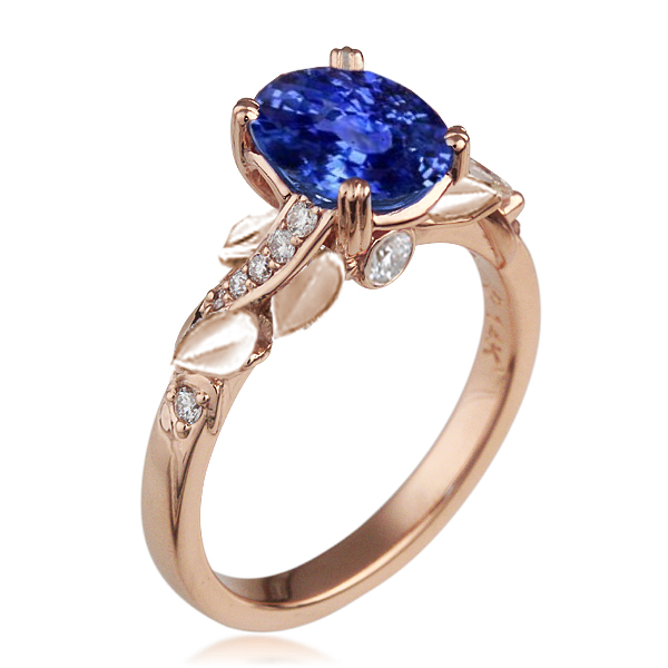Swirl and Curl Engagement Ring with Solid Leaves and Oval Sapphire Center Stone