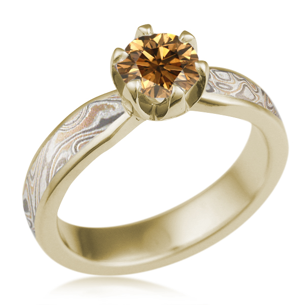 Mokume Solitaire Tapered with Prongs in yellow gold and Champagne Mokume, a round champagne center stone