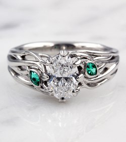 Embracing Tree Branch Engagement Ring with Emerald Accents
