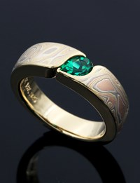 Mokume Wave Engagement Ring with Pear Cut Lab Emerald Solitaire